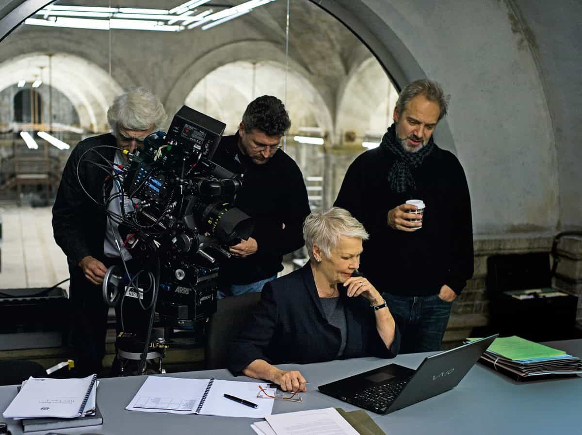 Judi Dench (center) and Director Sam Mendes (right) on the set of Metro-Goldwyn-Mayer Pictures/Columbia Pictures/EON Productions' action adventure SKYFALL.