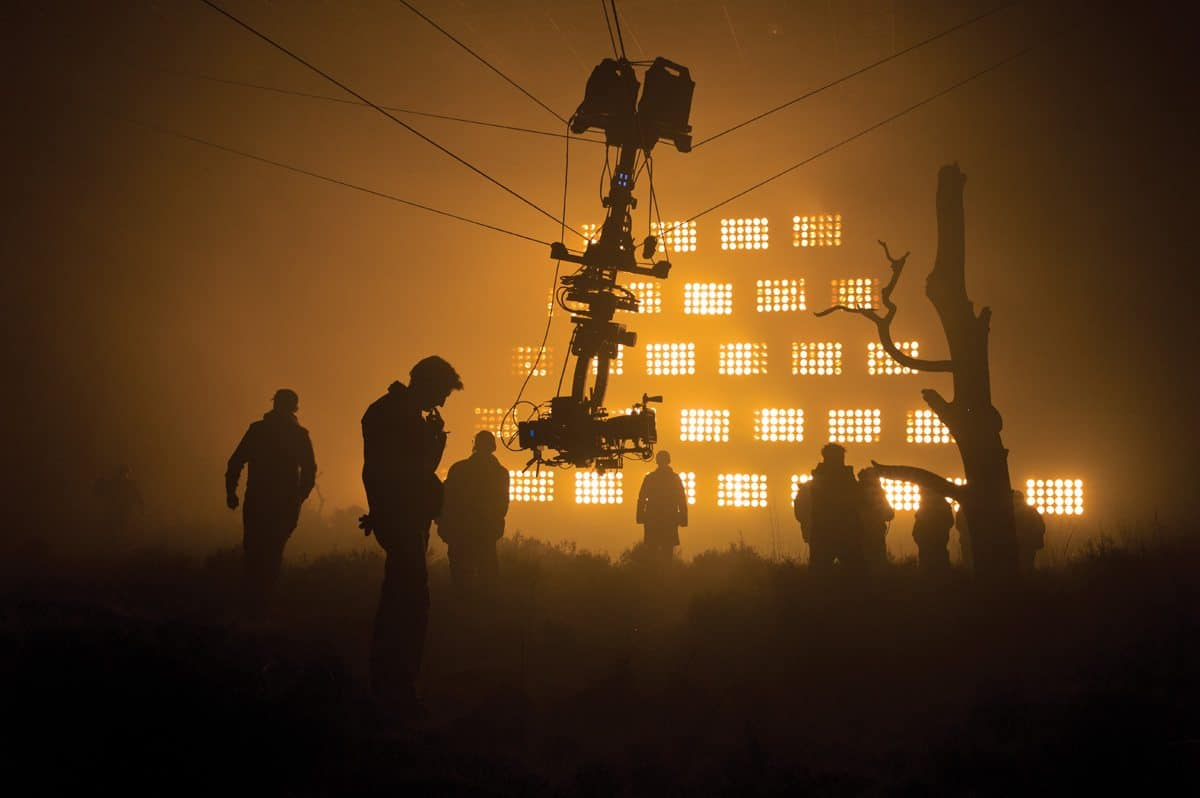 On the Scottish moor set with the lights representing fire in the background from Metro-Goldwyn-Mayer Pictures/Columbia Pictures/EON Productions' action adventure SKYFALL.