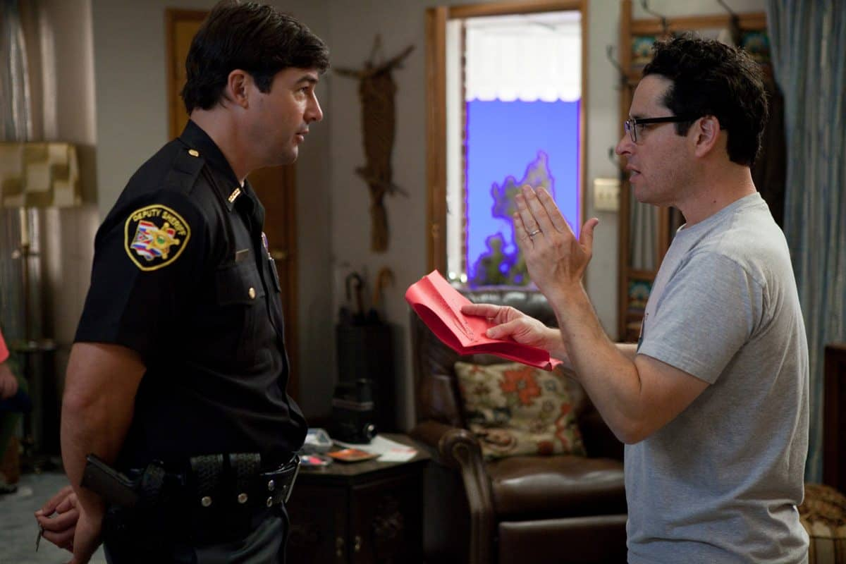 Left to right: Kyle Chandler (as Jackson Lamb) discuses a scene with director/writer/producer J.J. Abrams on the set of SUPER 8, from Paramount Pictures.