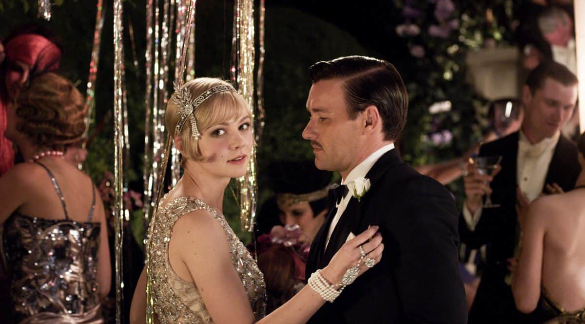 "(L-r) CAREY MULLIGAN as Daisy Buchanan and JOEL EDGERTON as Tom Buchanan in Warner Bros. Pictures' and Village Roadshow Pictures' drama ""THE GREAT GATSBY,"" a Warner Bros. Pictures release."