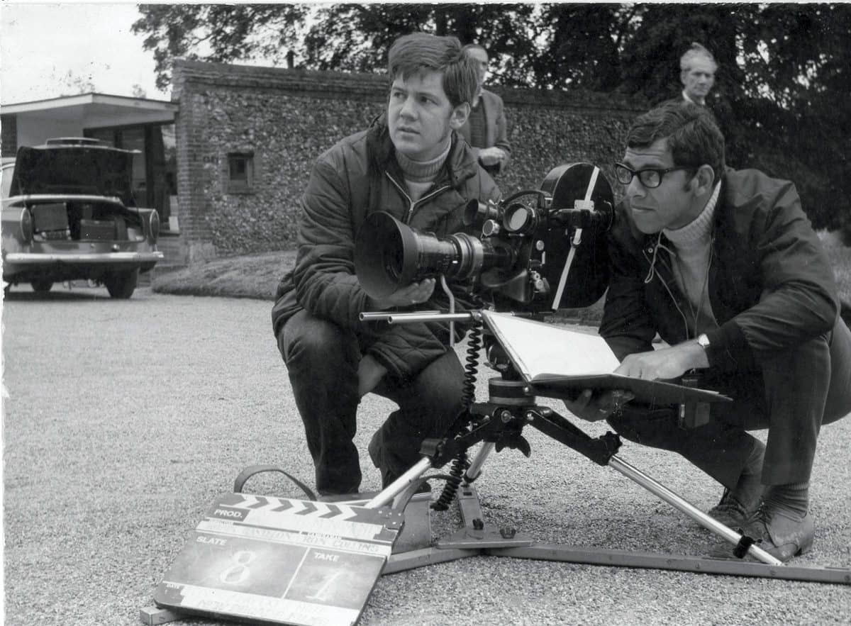 On location ... Ron Collins, wearing glasses, with assistant cameraman Michael Anderson on a shoot in Norfolk in 1962