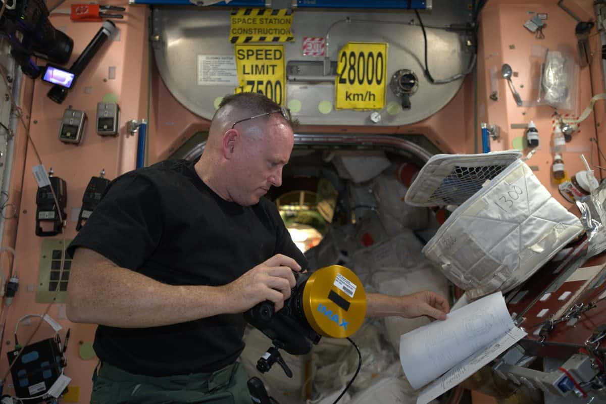 In orbit... Butch Wilmore with the IMAX Canon 1DC preparing for a shot aboard the ISS