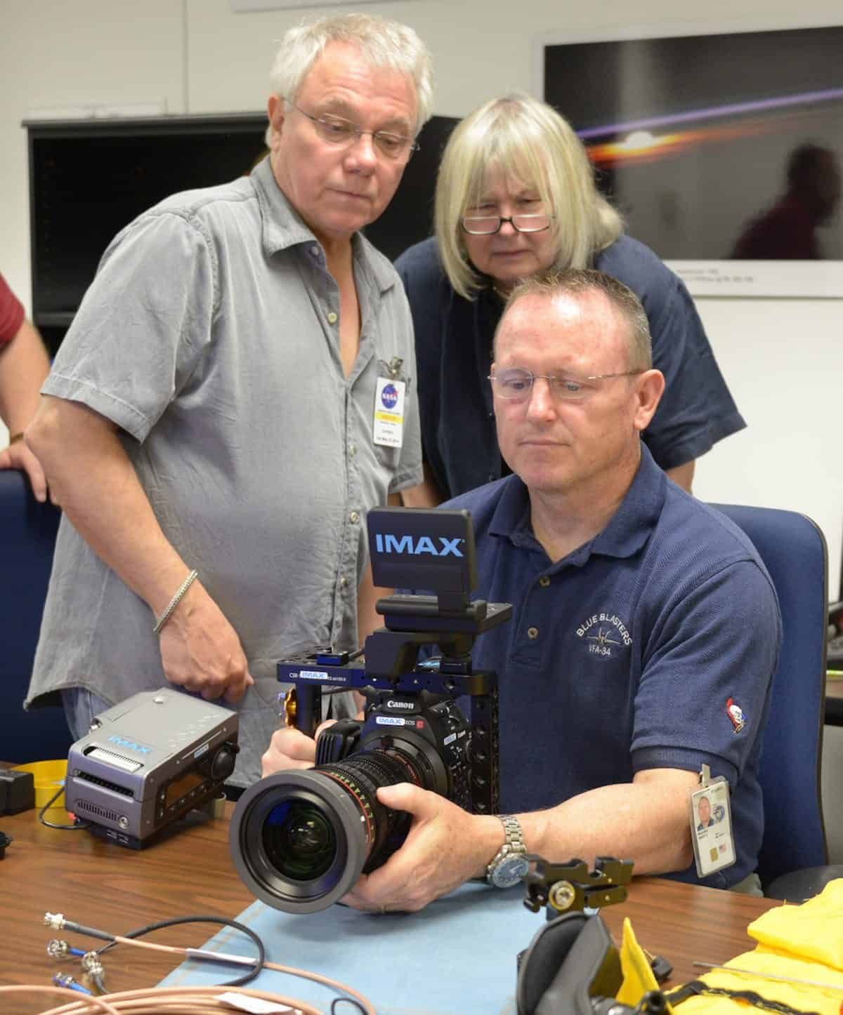 Training... James Neihouse ASC and director Toni Myers show astronaut Butch Wilmore the Codex recorder and Canon C500