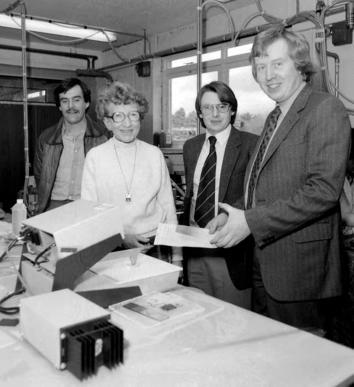 Ralph Young and Eddie Ruffell discuss the new computerised admin system with Doris, who ran the filter department for many years