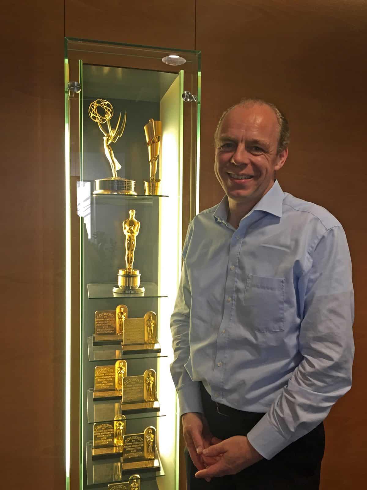Stephan Schenk beside the ARRI trophy cabinet