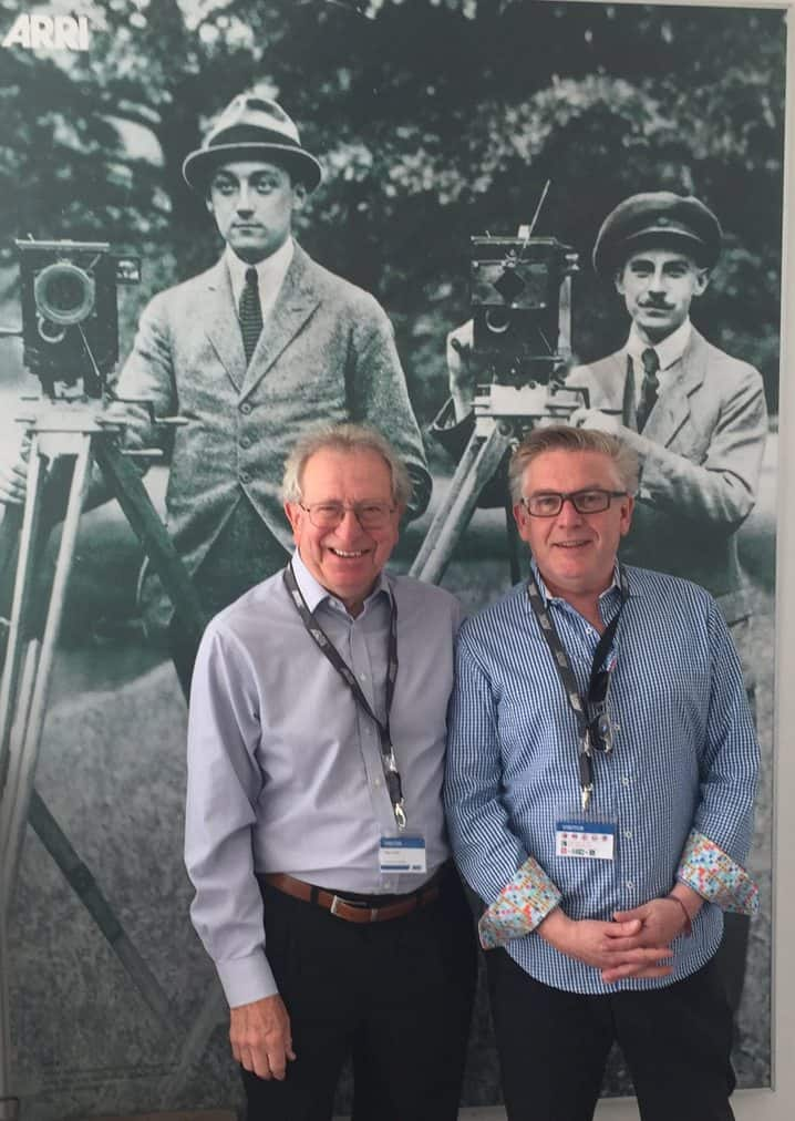 Alan Lowne and Ron Prince in front of ARRI founders Robert Richter & August Arnold