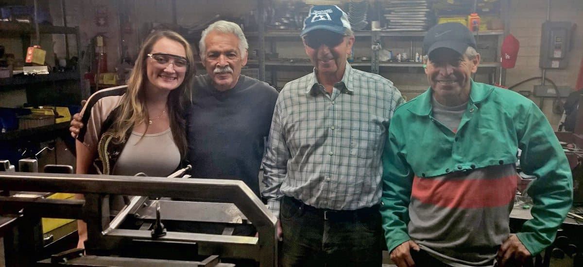 Leonard T. Chapman (third left) with some long-term workers: (l-r) Nichole Chapman-Huenergardt (Leonard's Granddaughter), Louis Perez and Porfirio Castro