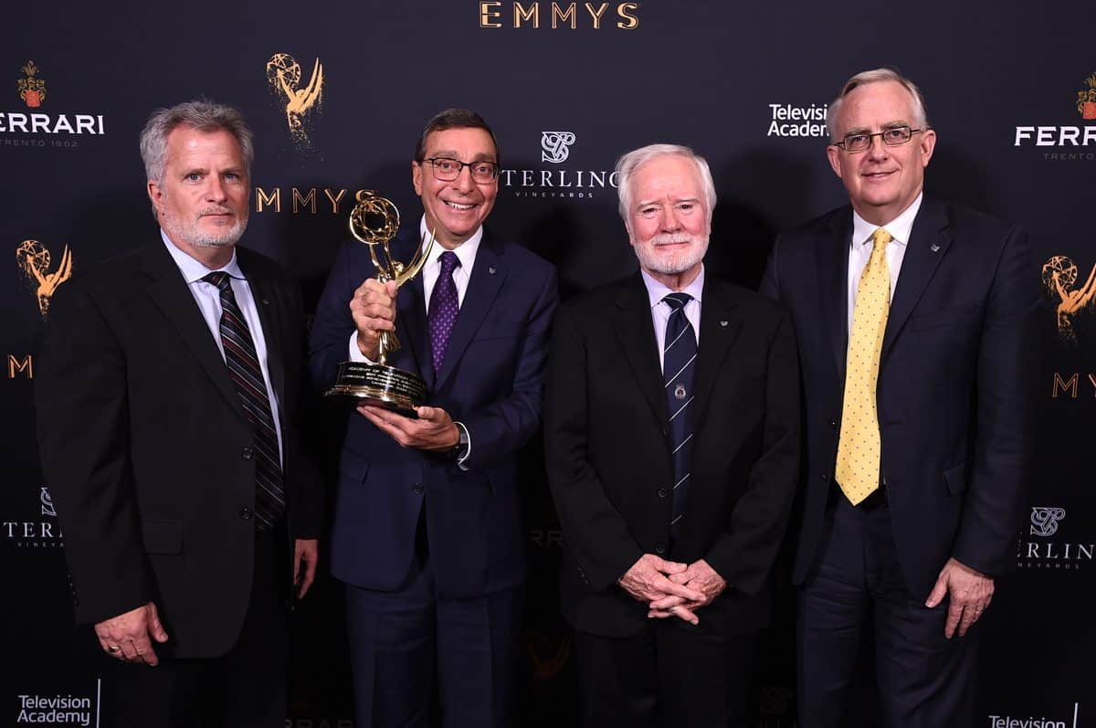 Tim Smith, from left, Elliot Peck, Larry Thorpe, and Scott Antaya pose with the Engineering Emmy Award for Canon 4k Zoom Lenses