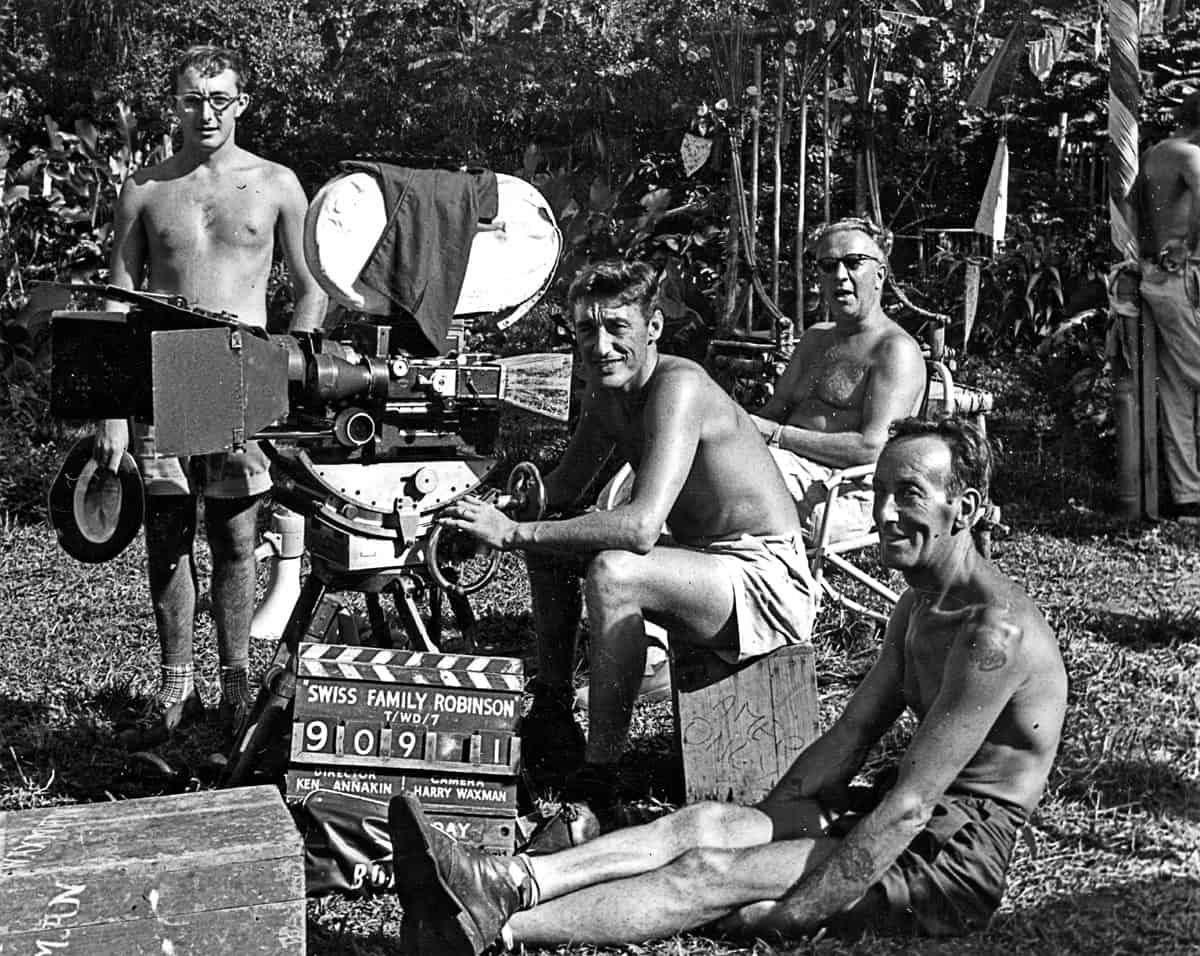 <em>Swiss Family Robinson</em>... pictured with Ernie Day (camera operator) and DP Harry Waxman BSC sitting in the background with dark glasses, while Ted Underwood (grip) relaxes on the grass