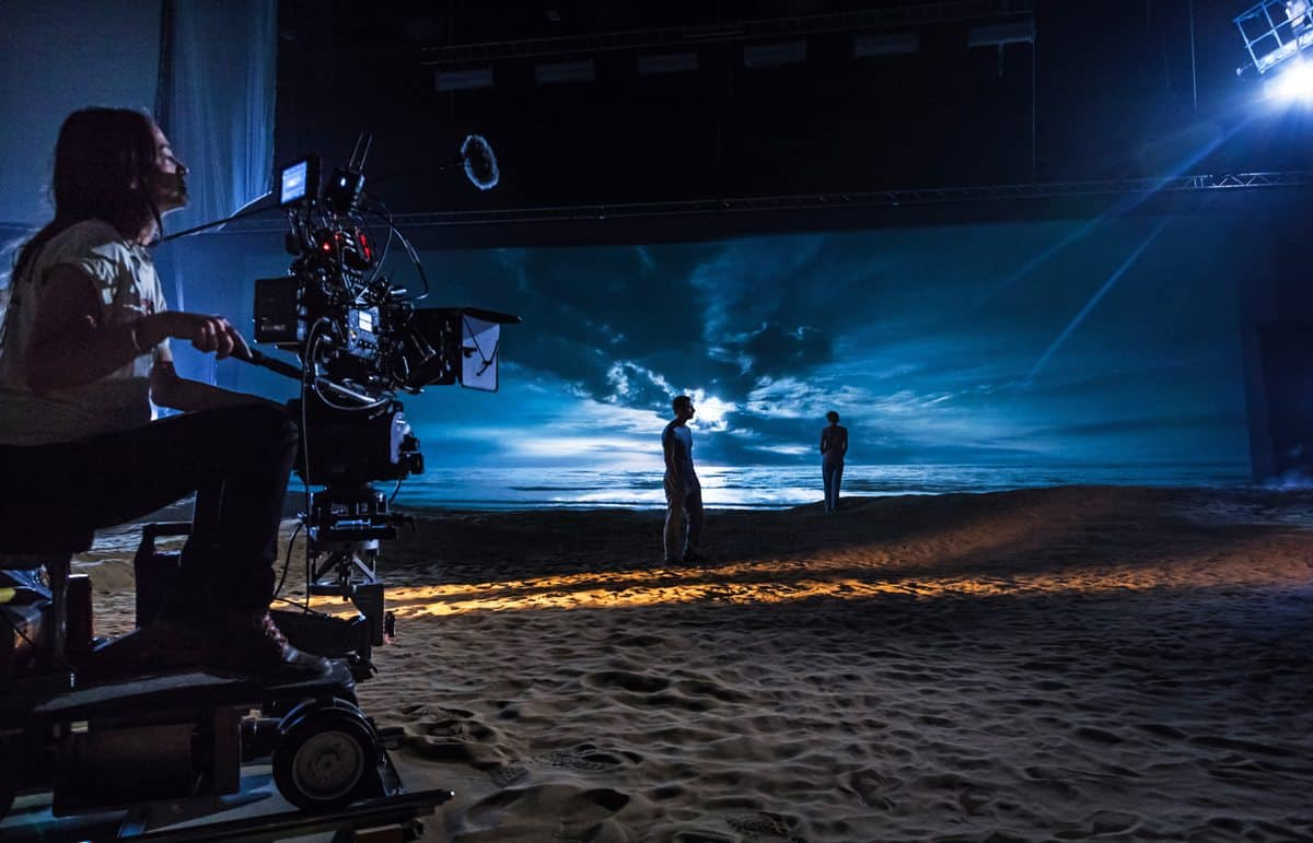 Ula on the dolly, framing up the back-projected translight on-set