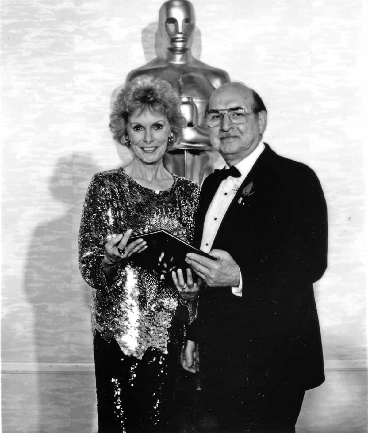 Nat Tiffen holds the Technical Achievement Award of Academy of Motion Picture Arts and Sciences, presented by Janet Leigh