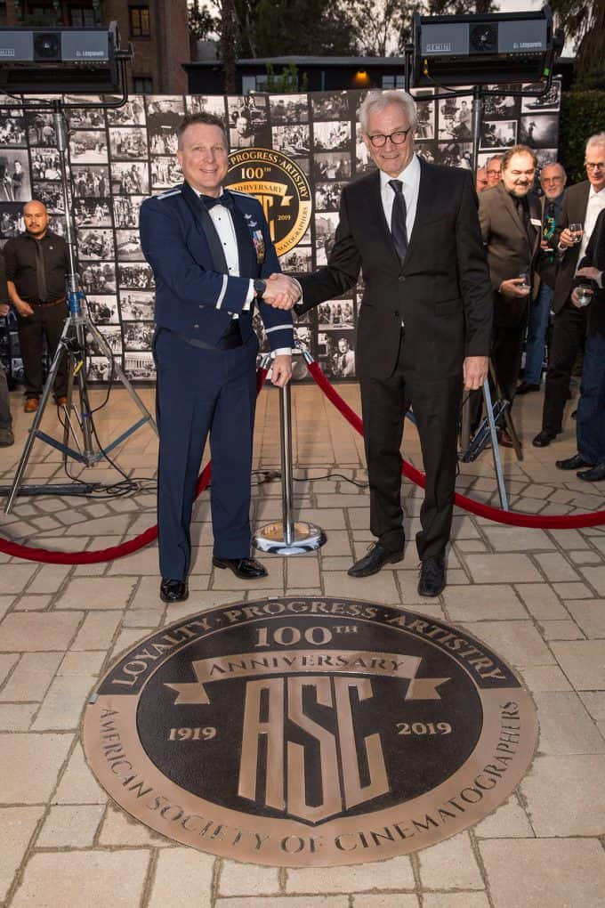 Colonel Terry Virts, alongside ASC President Kees van Oostrum, reveals the ASC's 100th Annoversary seal. Photo by Hector Sandoval