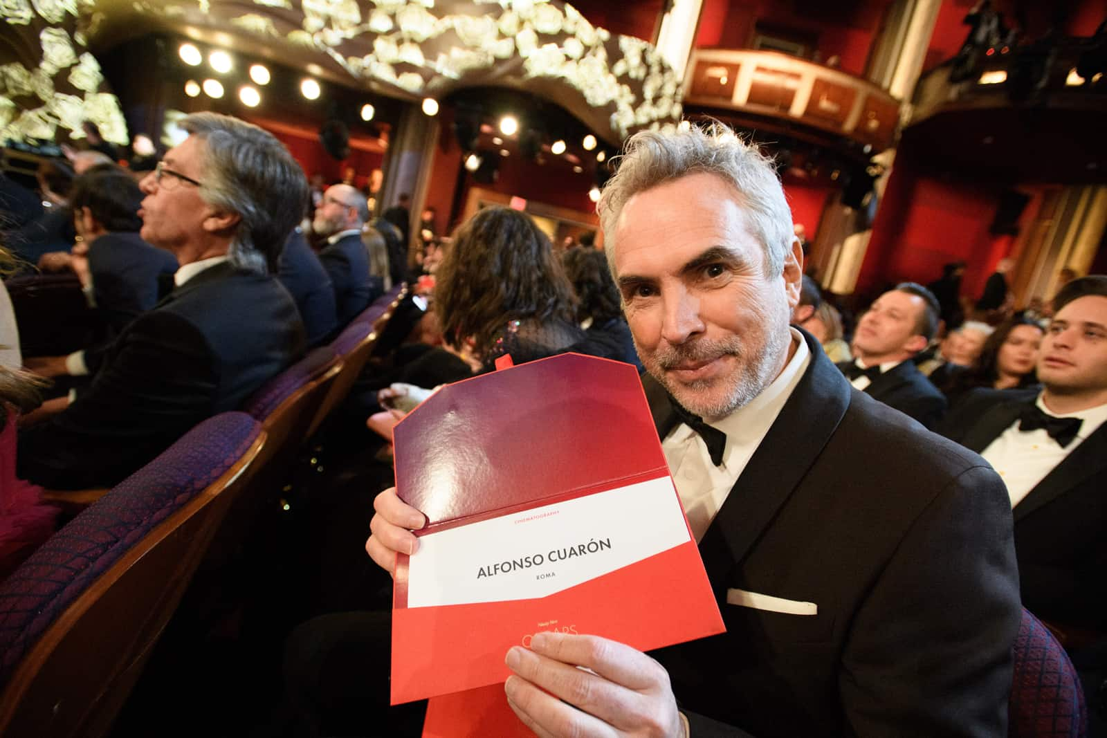 Alfonso Cuarón poses with the winning envelope for achievement in cinematography. Image: Richard Harbaugh / ©A.M.P.A.S.