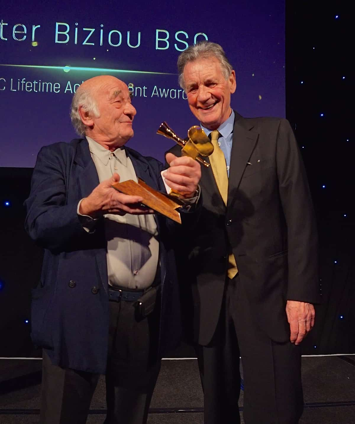 Peter Biziou BSC receives the BSC Lifetime Award from Sir Michael Palin