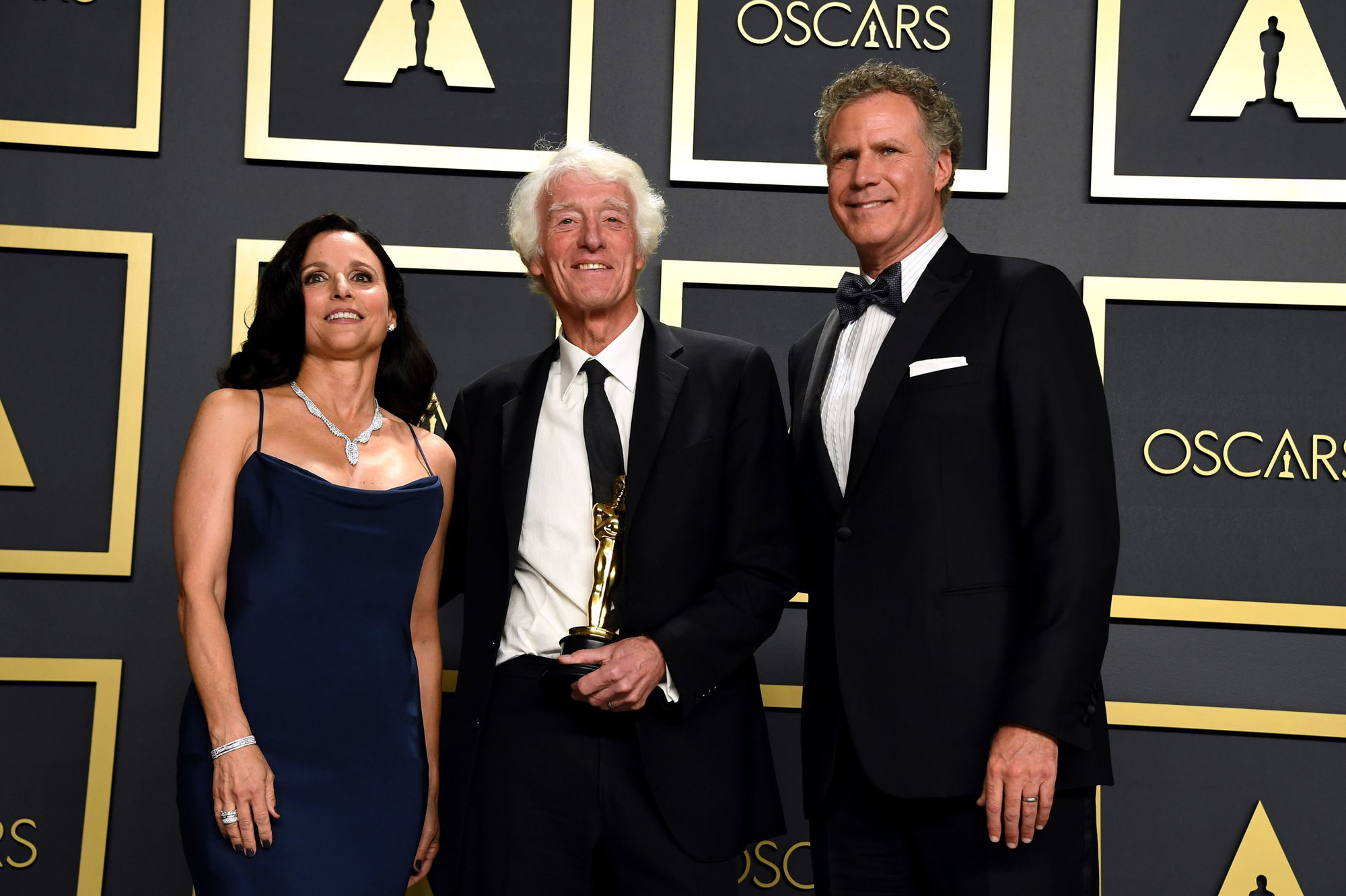 Julia Louis-Dreyfus and Will Ferrell present Roger Deakins with the Best Cinematography Oscar. Credit: Jennifer Graylock/PA Wire