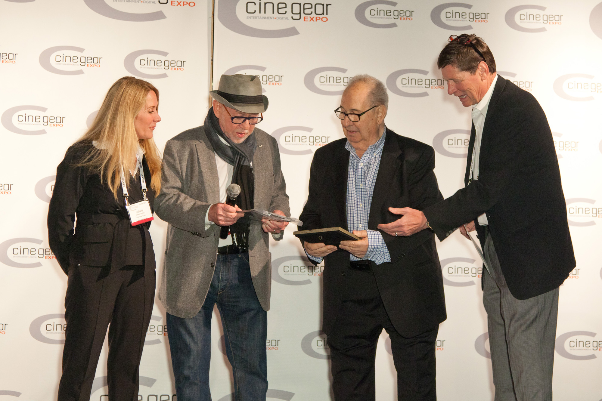 (l-r) Juliane Grosso (Cinegear expo LA owner /organiser), Steve Poster ASC (ICG president) presenting the Legacy award to George Dibie ASC and Karl Kresser (Cinegear expo LA owner /organiser). Photo by George Leon/Filmcastlive