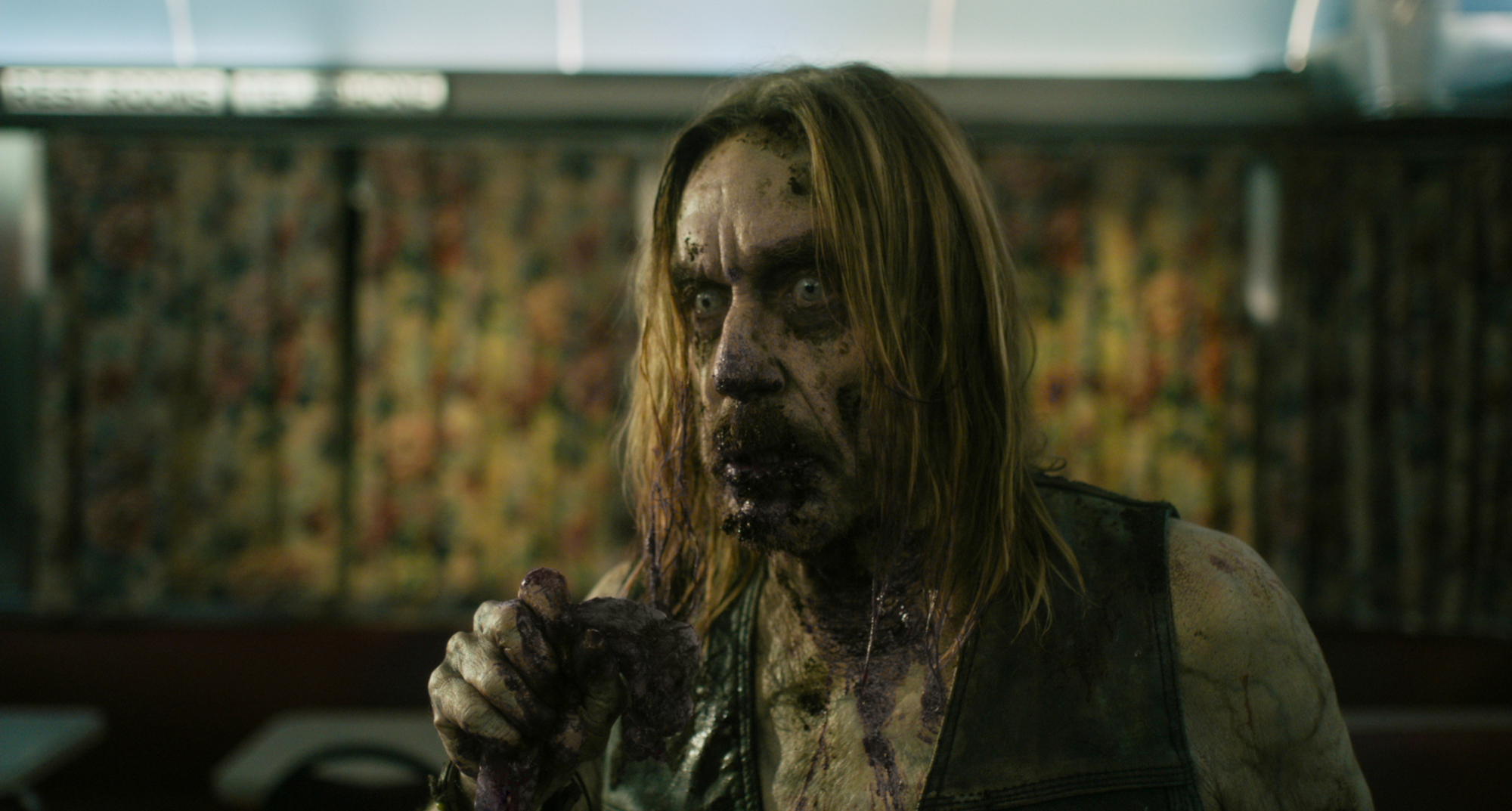 """Iggy Pop stars as """"Male Coffee Zombie"""" in writer/director Jim Jarmusch's THE DEAD DON'T DIE, a Focus Features release.  Credit : Frederick Elmes / Focus Features  © 2019 Image Eleven Productions, Inc."""