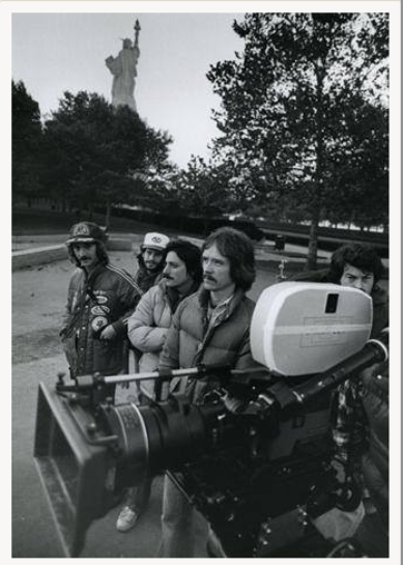 Dean Cundey ASC peeking out from behind the camera at right. From R-L: John Carpenter (director), Barry Bernardi (associate producer), Jeffrey Chernov (second AD)