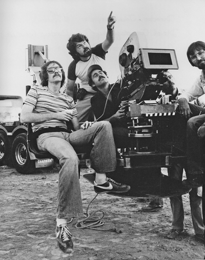 On the set of <em>Escape From New York</em>: Dean Cundey ASC points out a detail to (from left) director John Carpenter, camera operator Ray Stella, gaffer Mark Walthour and 1st AC Clyde Bryan