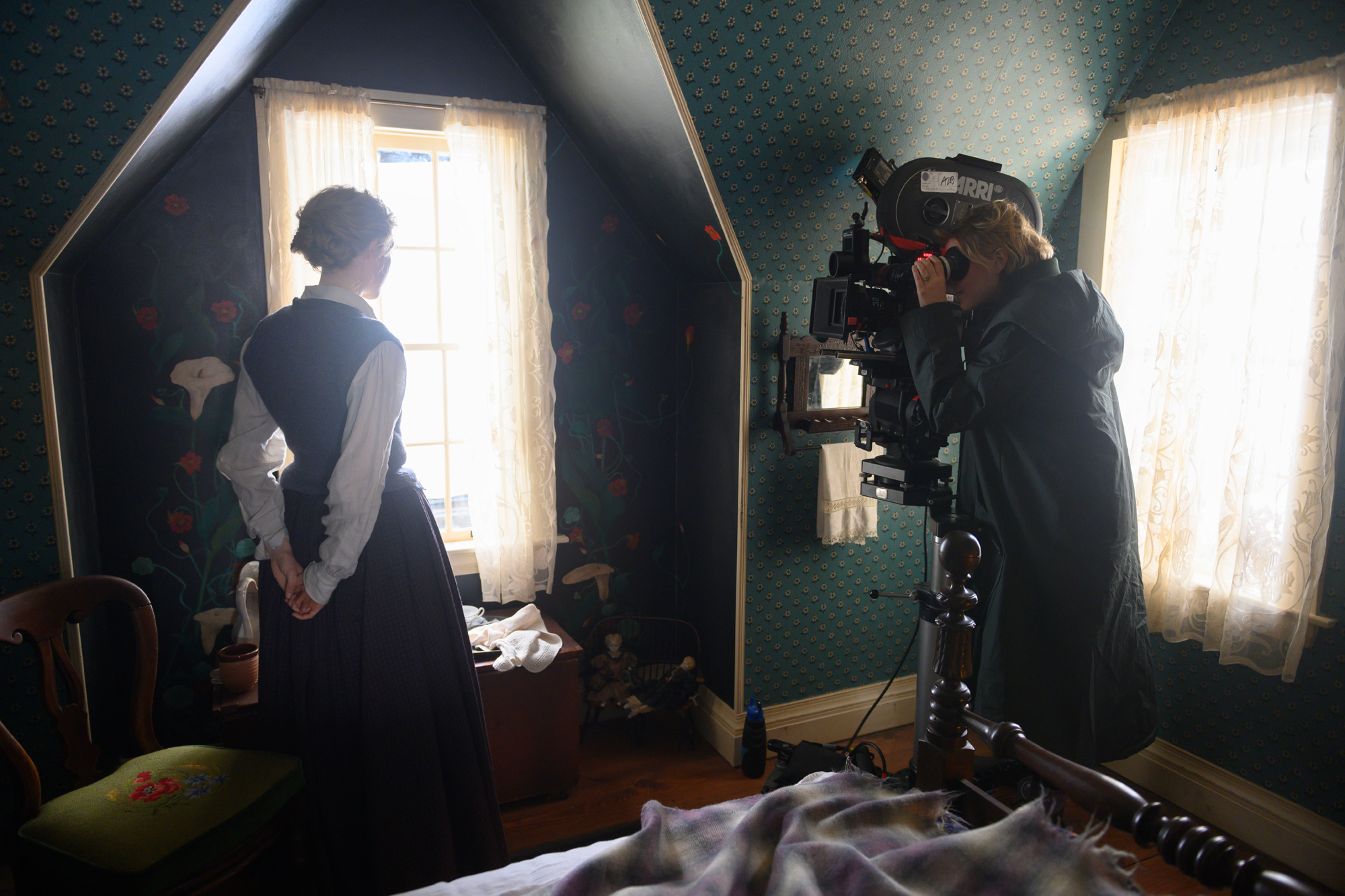 BTS:  Jo March (Saoirse Ronan)  Director/Writer Greta Gerwig on the set of Greta Gerwig's LITTLE WOMEN.   Location:  March house/2nd floor set on the stage in Franklin  MA""