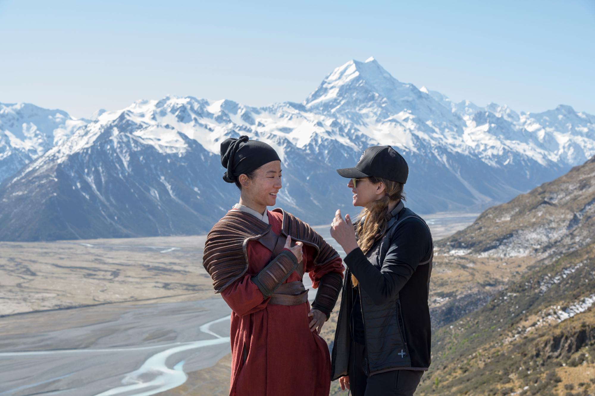 Yifei Liu (Mulan) on set with Director Niki Caro