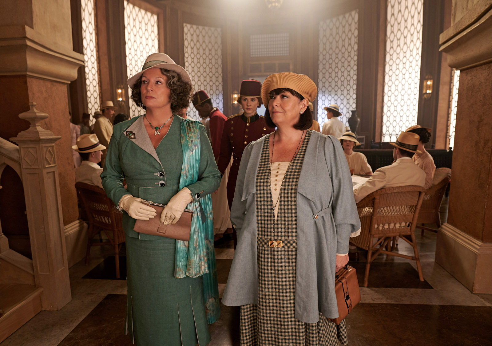 Jennifer Saunders as Marie Van Schuyler and Dawn French as Bowers in 20th Century Studios' DEATH ON THE NILE, a mystery-thriller directed by Kenneth Branagh based on Agatha Christie's 1937 novel. Photo by Rob Youngson. © 2020 Twentieth Century Fox Film Corporation. All Rights Reserved.