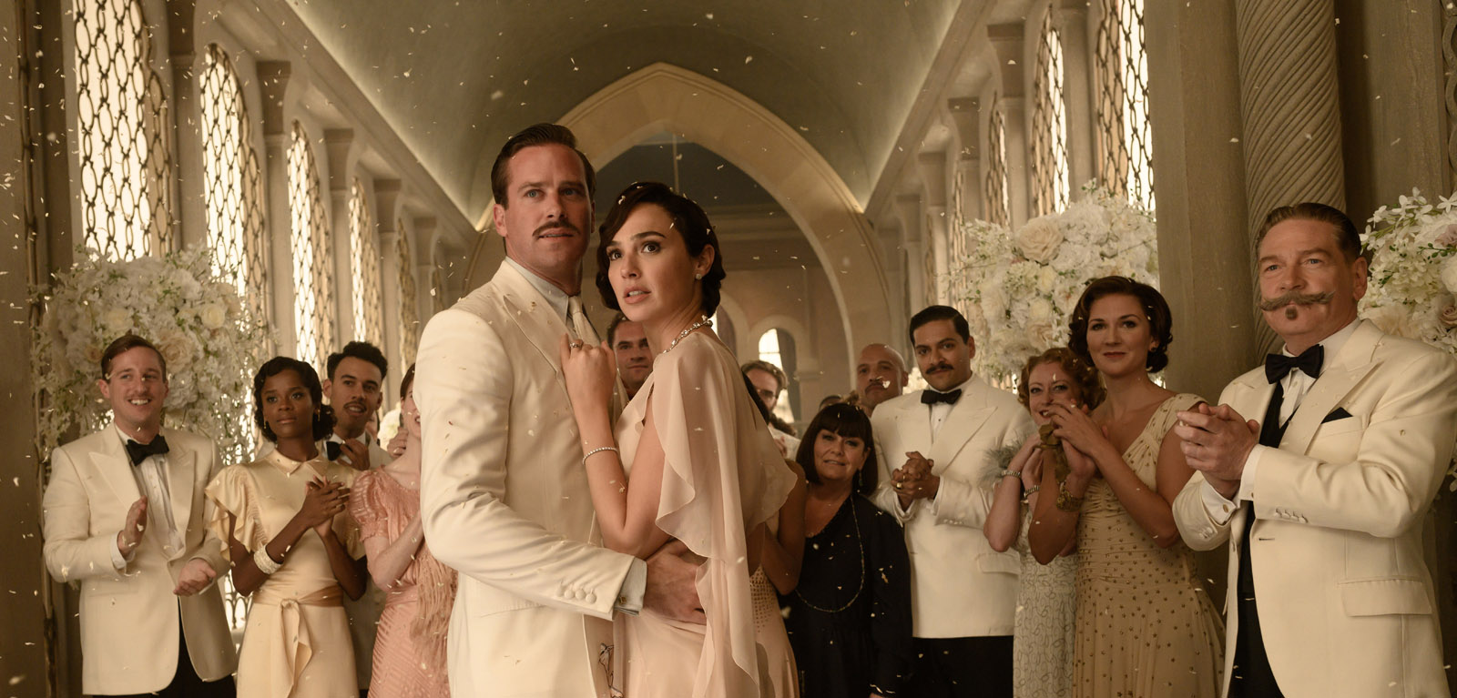 """In director Kenneth Branagh's mystery-thriller """"Death on the Nile"""" based on the 1937 novel by Agatha Christie, Simon Doyle (ARMIE HAMMER) and Linnet Ridgeway (GAL GADOT) are a picture-perfect couple on a honeymoon voyage down the Nile River which is tragically cut short. Wedding guests aboard the glamorous river steamer in this daring tale about the emotional chaos and deadly consequences triggered by obsessive love include Belgian sleuth Hercule Poirot (KENNETH BRANAGH) and an all-star cast of suspects. Twentieth Century Studios' """"Death on the Nile"""" opens in U.S. theaters October 23, 2020. Photo by Rob Youngson. © 2020 Twentieth Century Fox Film Corporation. All Rights Reserved."""