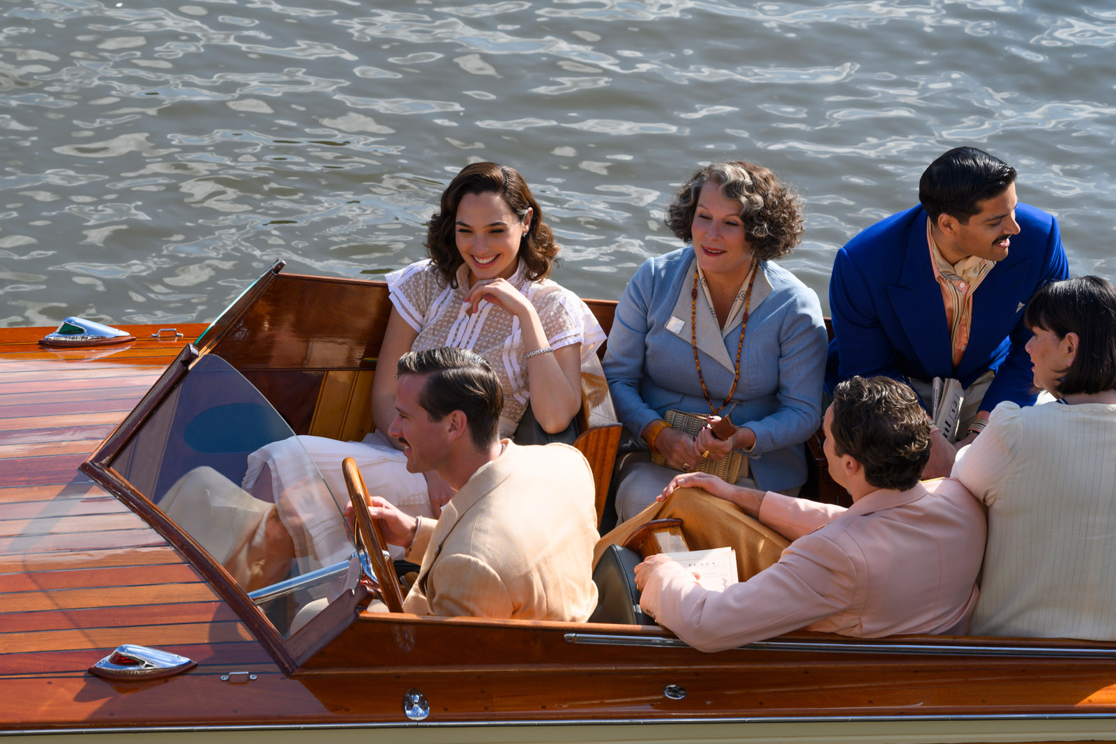(clockwise from top left) Gal Gadot as Linnet Ridgeway, Jennifer Saunders as Marie Van Schuyler, Ali Fazal as Andrew Katchadourian, Dawn French as Bowers, Tom Bateman as Bouc and Armie Hammer as Simon Doyle in 20th Century Studios' DEATH ON THE NILE, a mystery-thriller directed by Kenneth Branagh based on Agatha Christie's 1937 novel. Photo by Rob Youngson. © 2020 Twentieth Century Fox Film Corporation. All Rights Reserved.