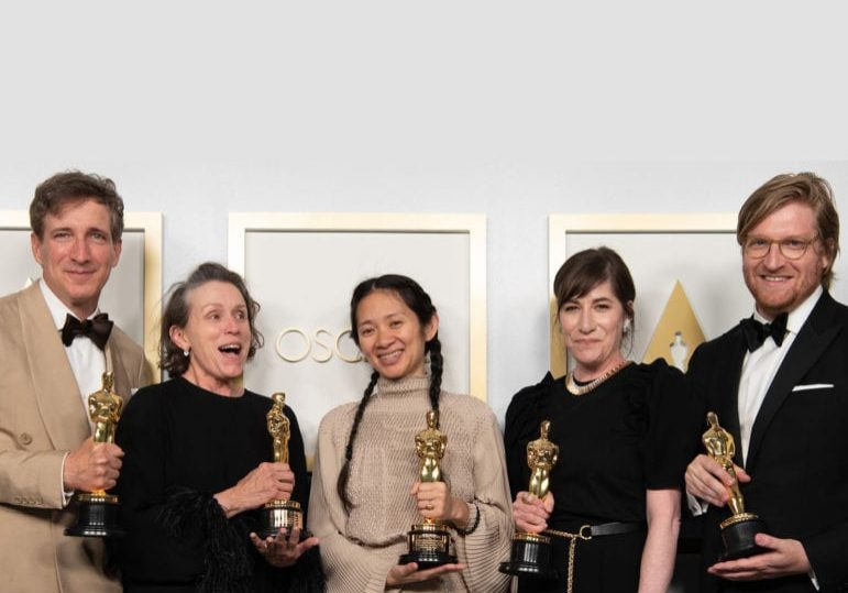 Peter Spears (from left), Frances McDormand, Chloé Zhao, Mollye Asher, and Dan Janvey pose backstage with the Oscar® for Best Picture. Matt Petit / ©A.M.P.A.S.