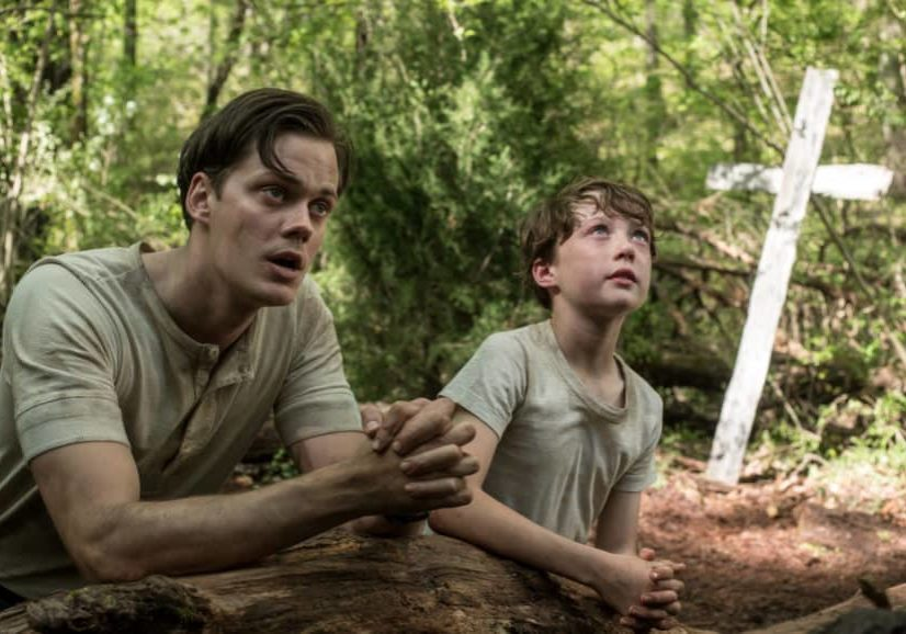 The Devil All The Time (L-R) Bill Skarsgård as Willard Russell, Michael Banks Repeta as Arvin Russell (9 Years Old). Photo Cr. Glen Wilson/Netflix © 2020